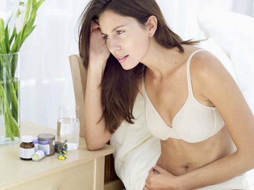 Làm sao để giảm đau bụng kinh